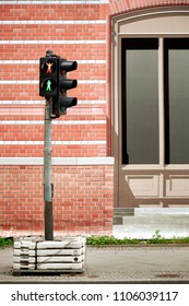 Humorous red and green traffic lights concept. Provisional traffic light against fictitious street canvas.