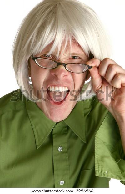 Humorous shot of thirty something man in white wig making crazy expression.
