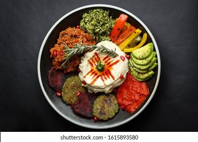 humus platter on dark background