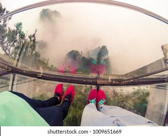 HUNAN,CHINA 1 September 2017 - two tourists stand on the sky glass pathway at Tianmen mountain,Zhangjiajie
