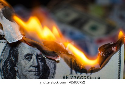 A hundred dollar bill in American US currency is on fire