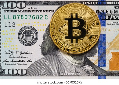 Hundred dollar bill with bitcoin covered face. Anonymous payment concept.