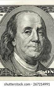 Hundred dollar bill close-up fragment, Benjamin Franklin.