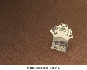 Hundred dollar bill folded into a shirt