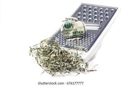 Hundred dollar bill shredded on kitchen hand shredder
