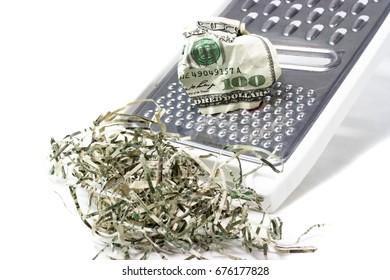 Hundred dollar bill shredded on kitchen hand shredder.