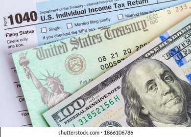 Hundred Dollar Bill with Tax Refund Check and Form 1040.