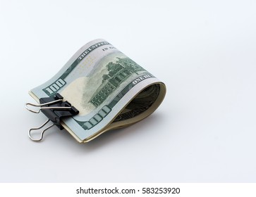 Hundred dollar bills with clip close up isolated on white background