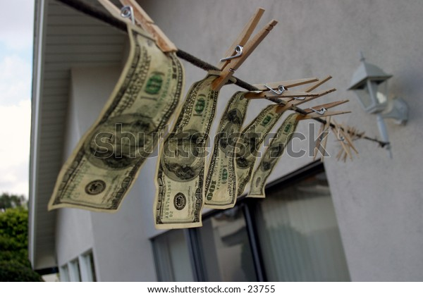 Hundred dollar bills hanging on a rope.  Money laundering concept