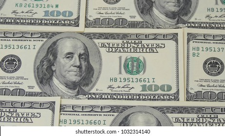 Hundred dollar bills. Macro photography of banknotes. The motion camera slider. Portrait of Benjamin Franklin - 2