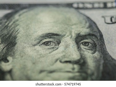 Hundred dollars bill - Benjamin Franklin. Selective focus on eyes