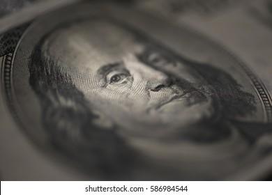 Hundred dollars bill - Benjamin Franklin. Selective focus