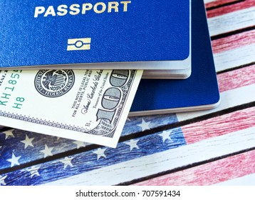 Hundred dollars and two blue passports. Immigration to the United States concept