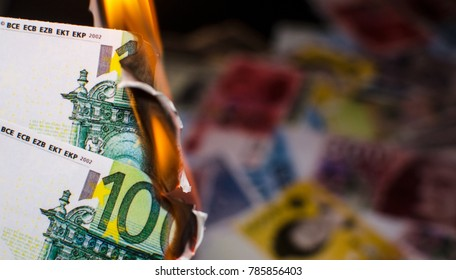A hundred euro bill in Europe currency is on fire