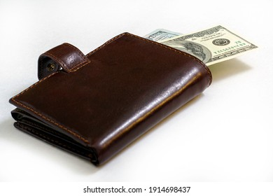hundred-dollar bills sticking out of a leather purse. High quality photo