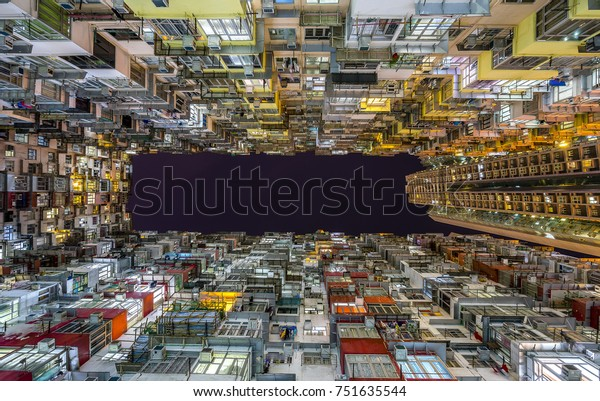 Hundreds of apartments squeezed together in one of the most famous apartment blocks the Yick Fat Building in Hong Kong.