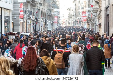 Hundreds of diverse People walking along Istiklal street most popular shopping and entertainment place during weekends. Istiklal Caddesi, Istanbul, Turkey, November 19, 2016