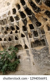 Hundreds of niches in an ancient columbarium (dovecote) cut into natural rock and used during the Hellenistic and Roman periods to breed doves for meat and feces for fertilizer (Midras ruins, Israel)