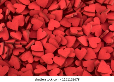 Hundreds of small red painted hearts