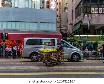 Hung Hom, Hong Kong - An elderly man pushing a cart of used carton near Hung Hom traditional market, Oct 2018