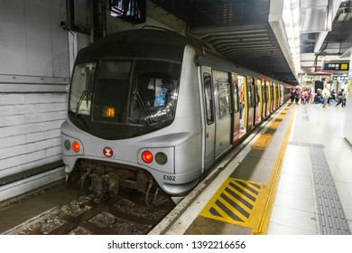HUNG HOM, HONG KONG - FEB 24, 2018: An MTR East Rail Line metro train stopping at Hung Hom Terminus platform. This train is known as Mid-Life Refurbishment (MLR) train made by Metro Cammell