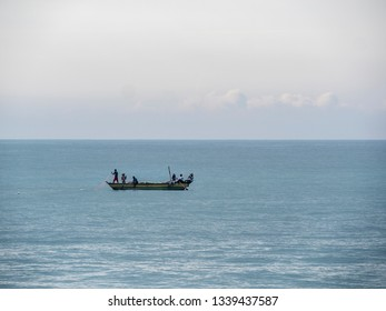 Hungama, Shri Lanka - February 09, 2019: fishermen working on their outrigger boat at Hungama, Shri Lanka