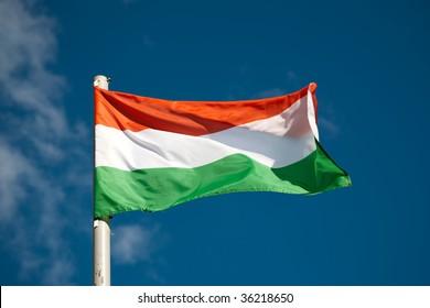 Hungarian flag against blue sky