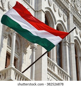 Hungarian flag on the wall of the parliament building