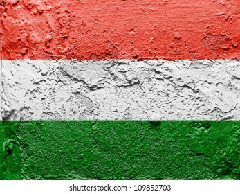 The Hungarian flag painted on grunge wall