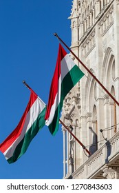 Hungarian flags on the Hungarian Parliament Building on a sunny winter morning.
