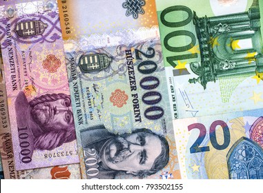 Hungarian forint and euro banknotes on a plain surface. Forint euro exchange rate.