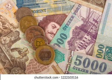 Hungarian Forint Notes and Coins as a overlay on a table
