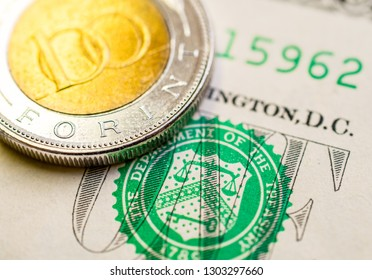 Hungarian forint US dollar exchange rate: Hungarian 100 forint coin placed on 1 dollar bill