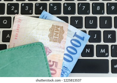 Hungarian Forints Banknotes on a black keyboard