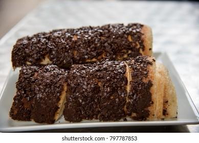 Hungarian kurtos kalacs - chimney cake served with brown chocolate sprinkles, Kürt?skalács