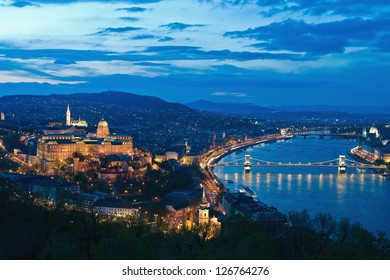 Hungarian landmarks, Chain Bridge and Royal Palace in Budapest by night.