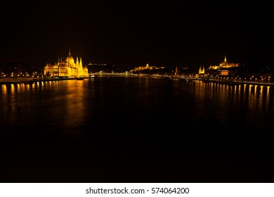 Hungarian National Parliament Building located at the bank of Dunabe river with famous Chain Bridge connecting Buda and Pest in Budapest, Hungary