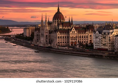 Hungarian Parliament (Országház) in Budapest at sunrise. Danube river on foreground.
