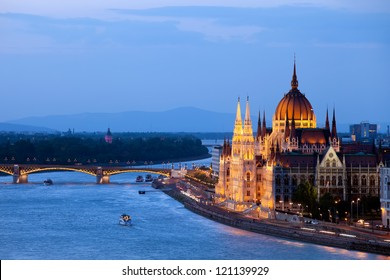 Hungarian Parliament Building and Danube river at evening in Budapest, Hungary.