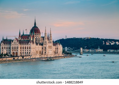 Hungarian Parliament Building with Danube river at sunset in Budapest, Hungary