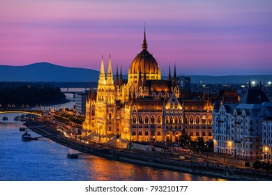Hungarian Parliament Building illuminated at twilight in city of Budapest, Hungary