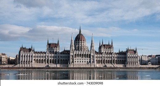 Hungarian parliament building at winter, ice drift on Danube river (Budapest)