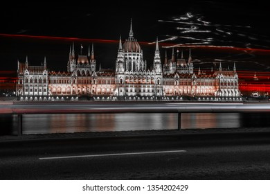 The Hungarian Parliament with the lights of the cars