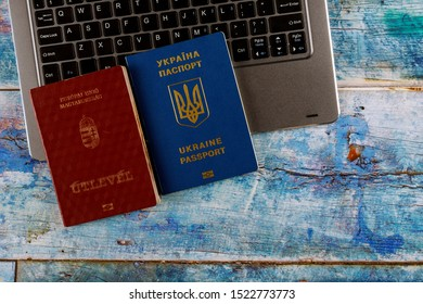 The Hungarian passports and Ukrainian passport with computer keyboard application form or registering in dual citizenship