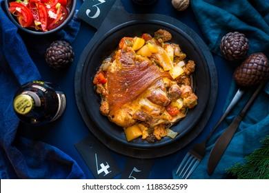 hungarian pork leg with potato, tomato, oinon and paprika