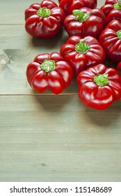 hungarian sweet peppers, wooden table background