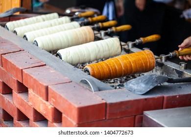 Hungarian Twist Roll. Hungarian Kurtoskalacs prepared on the grill, at a traditional street food market