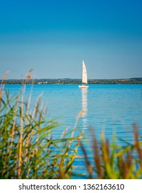 BALATONALMÁDI, HUNGARY - 17 AUGUST, 2018: Sailboat on lake Balaton on 17 August, 2018
