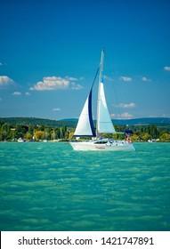 BALATONALMÁDI, HUNGARY - 17 AUGUST, 2018: Sailboat on lake Balaton on 17 August, 2018