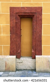 Hungary. Budapest. Ancient door in the ancient walled construction.